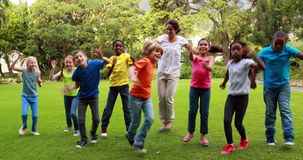 Teacher and pupils dancing together stock footage