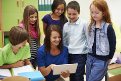 Teacher with pupils Stock Image