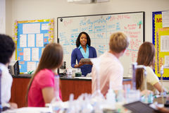 Teacher And Pupils In High School Science Class Stock Photo