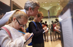 Teacher And Pupils Looking At Artifacts On Display In Museum Stock Images