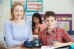 Teacher With Pupils In Science Lesson Studying Robotics Royalty Free Stock Image