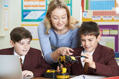Teacher With Pupils In Science Lesson Studying Robotics Stock Images