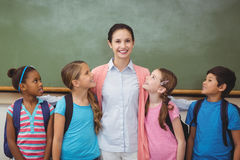Teacher and pupils smiling in classroom Royalty Free Stock Image