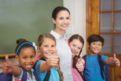 Teacher and pupils smiling in classroom Stock Photography