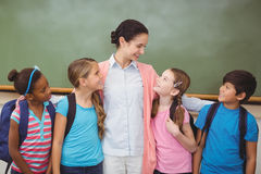 Teacher and pupils smiling in classroom Royalty Free Stock Images
