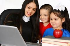 Teacher with pupils Royalty Free Stock Photos