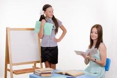 Teacher puts exellent student Stock Photos