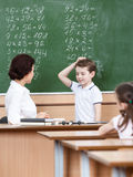 Teacher questions the pupil. Math teacher questions the pupil who doesn't know the answer Stock Images