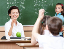 Teacher questions pupils at algebra stock image