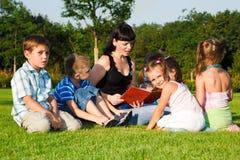 Teacher reading Royalty Free Stock Photos