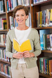 Teacher reading book at library Royalty Free Stock Photography