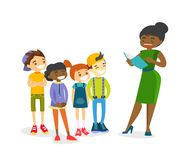 Teacher reading a book to multiethnic children. Royalty Free Stock Photography