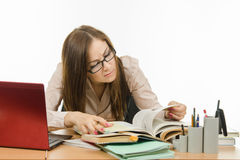 Teacher reading something in a textbook Stock Images