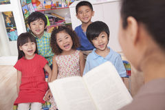 Free Teacher Reading To Her Students Royalty Free Stock Photo - 33372995