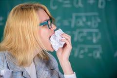 Teacher ready to eat her paperwork. Teacher eats piece of paper absorb information. Woman teacher eats crumpled piece of. Paper chalkboard background. Thirst of stock photo