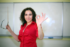 Teacher in a red shirt Royalty Free Stock Photo