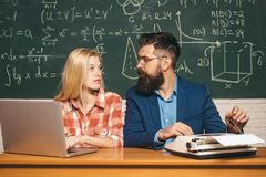 Teacher respects students. Science and education concept. Tutor. Bearded tutor helping his student. Back to school and royalty free stock photography