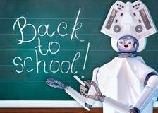 Teacher robot with artificial intelligence in school class blackboard. Royalty Free Stock Image