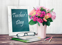 Teacher's day holiday card.Chalk board and flower vase. Royalty Free Stock Image
