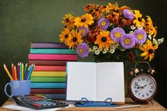 Teacher`s day, September 1. Back to school. Bouquet and book. Stock Image