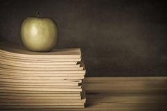 Teacher's Desk - Apple on Books Royalty Free Stock Photo
