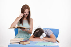 The teacher saw sleeping student Stock Images