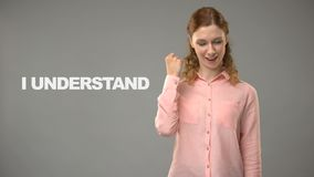 Teacher saying i understand in asl, text on background, communication for deaf. Stock footage stock video footage
