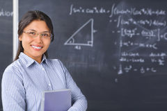 Teacher or Scholar pose in front of blackboard royalty free stock image