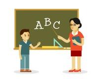 Teacher and school boy near blackboard in flat style Royalty Free Stock Images