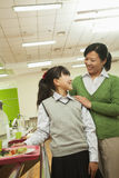 Teacher and school girl portrait in school cafeteria Royalty Free Stock Images