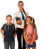 Teacher with school kids isolated over white background Stock Photo