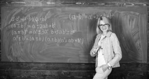 Teacher on school lesson at blackboard. woman in classroom. Home schooling. happy woman. Back to school. Teachers day. Study and education. Modern school royalty free stock images