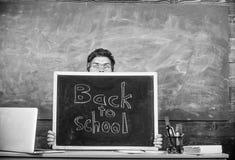 Teacher or school principal welcomes inscription back to school. Teachers life full of stress. Man scared beginning. School year. Educator hiding behind royalty free stock image