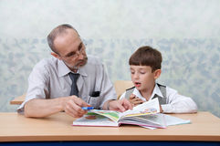 Teacher and schoolboy Royalty Free Stock Photography