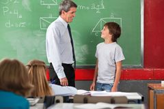 Teacher And Schoolboy Looking At Each Other In Stock Photos