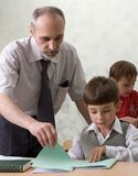 Teacher and schoolboys Stock Photos