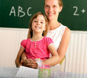 Teacher and schoolchild Stock Photography
