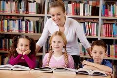 Teacher and schoolchildren royalty free stock images