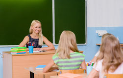 Teacher and schoolchildren in classroom at lesson.  Royalty Free Stock Image