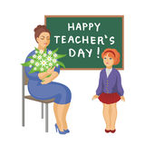 Teacher and schoolgirl. The schoolgirl has presented to the teacher flowers Stock Image