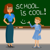 Teacher and schoolgirl writing on chalk board. Back to school. Royalty Free Stock Photography