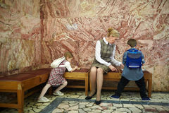 Teacher and schoolkids in museum royalty free stock images