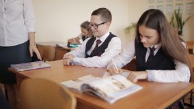 Teacher scolding a naughty student, who launches paper airplanes in class. stock footage