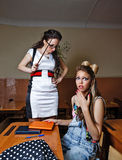 Teacher scolds a pupil for failure of homework. Royalty Free Stock Images