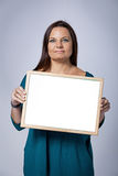 Teacher Showing a Blank White Board Royalty Free Stock Images