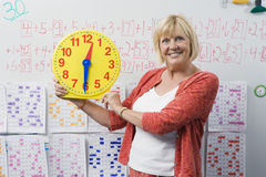 Teacher Showing Class A Clock Stock Photo
