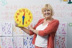 Teacher Showing Class A Clock Stock Photo