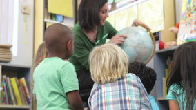 Teacher Showing Group Of Elementary Age Schoolchildren Globe Stock Photography