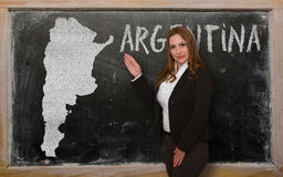 Teacher showing map of argentina on blackboard Stock Photos