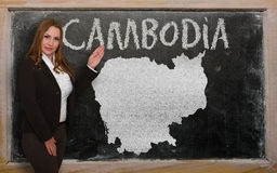 Teacher showing map of cambodia on blackboard. Successful, beautiful and confident young woman showing map of cambodia on blackboard for presentation, marketing Royalty Free Stock Photography